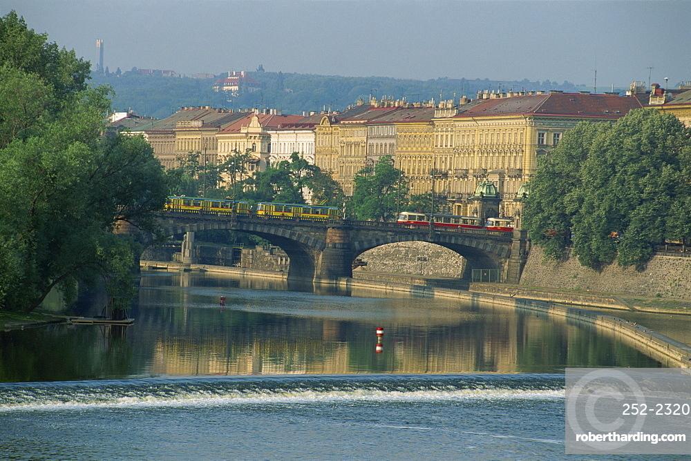 Bridge and weir on the River Vltava, Prague, Czech Republic, Europe