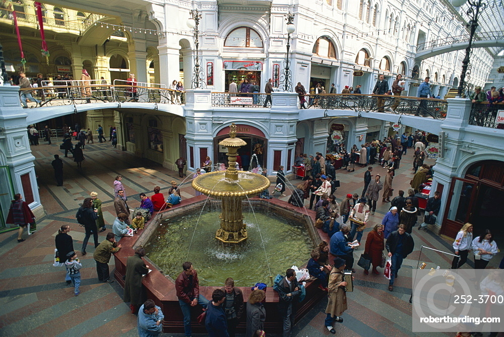 Crowds around the water fountain in the Gum department store, Moscow, Russia, Europe