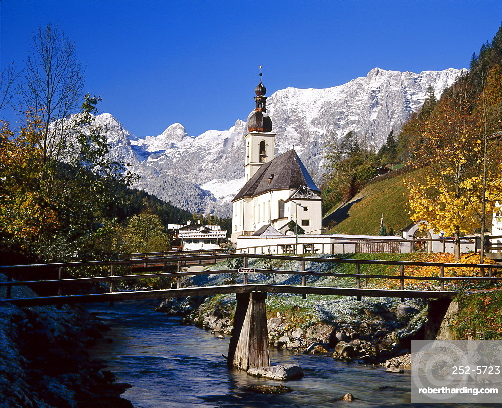 Wooden bridge in front of the church at Ramsau in the mountains of Bavaria, Germany