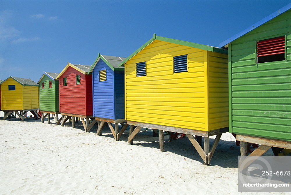 Brightly painted beach bathing huts at False Bay, Muizenburg, Cape Town, South Africa *** Local Caption ***