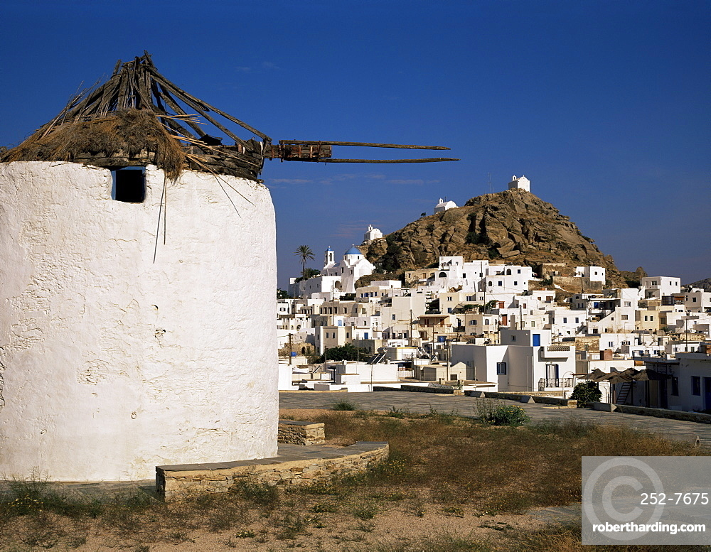 Old windmill and the main town of Hora, Ios, Cyclades, Greek Islands, Greece, Europe