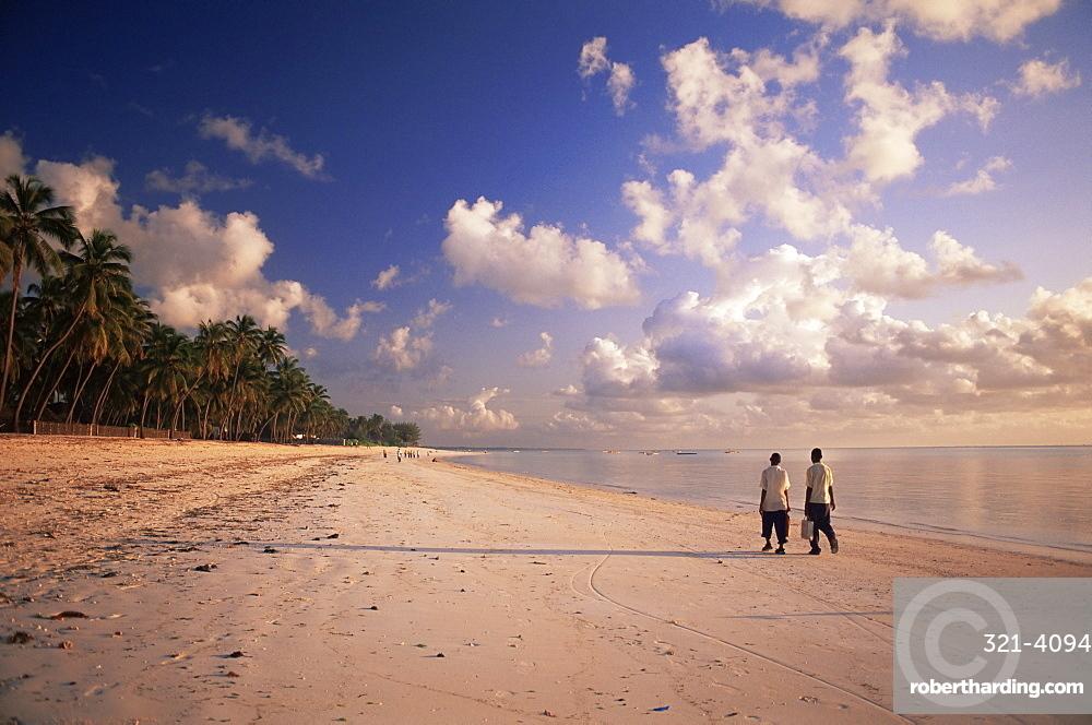 Two boys walking to school along the beach at Jambiani, Zanzibar, Tanzania, East Africa, Africa