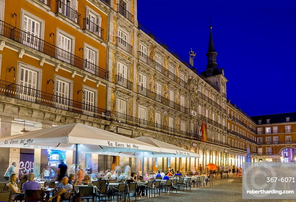 Plaza Mayor cafes at dusk, Madrid, Spain, Europe
