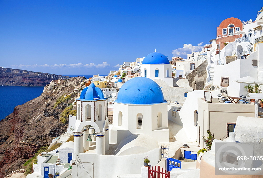 Greek church with three blue domes in the village of Oia, Santorini (Thira), Cyclades Islands, Greek Islands, Greece, Europe