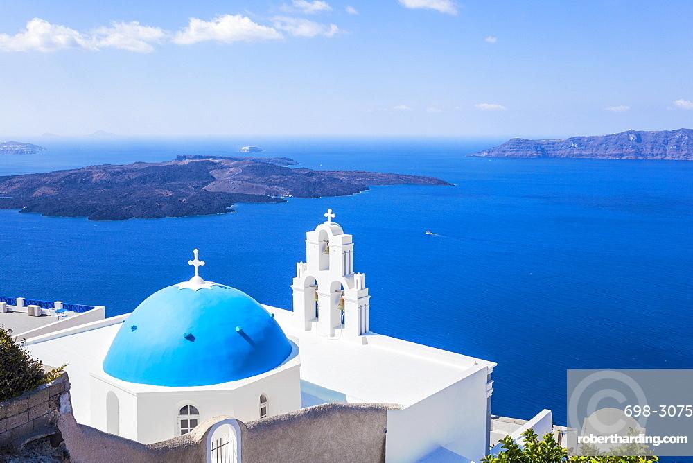 Blue dome and bell tower above Aegean Sea, St. Gerasimos church, Firostefani, Fira, Santorini (Thira), Cyclades Islands, Greek Islands, Greece, Europe