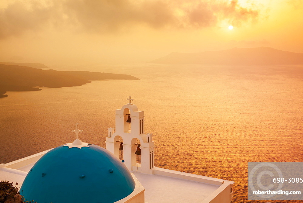 Blue dome and bell tower at sunset, St. Gerasimos church and Aegean Sea, Firostefani, Fira, Santorini (Thira), Cyclades Islands, Greek Islands, Greece, Europe