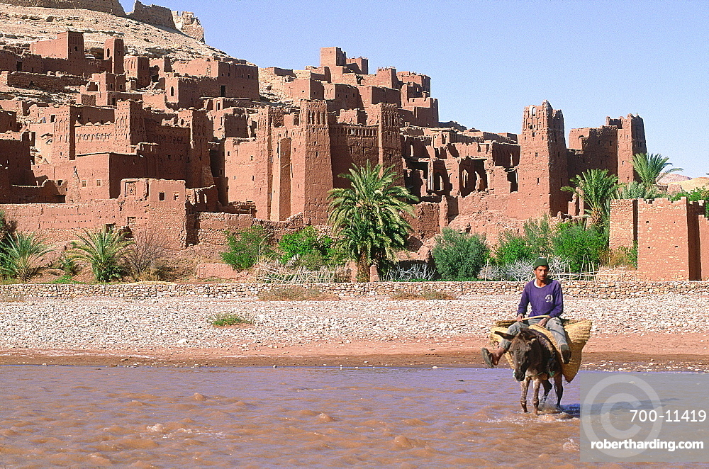 Morocco, South, Ouarzazate Region, Ait Benhaddu Ksar Ruins (Ancient Adobe Fortress And Village), Overview On The Ramparts And River (Oued), Peasant Crossing On His Donkey)