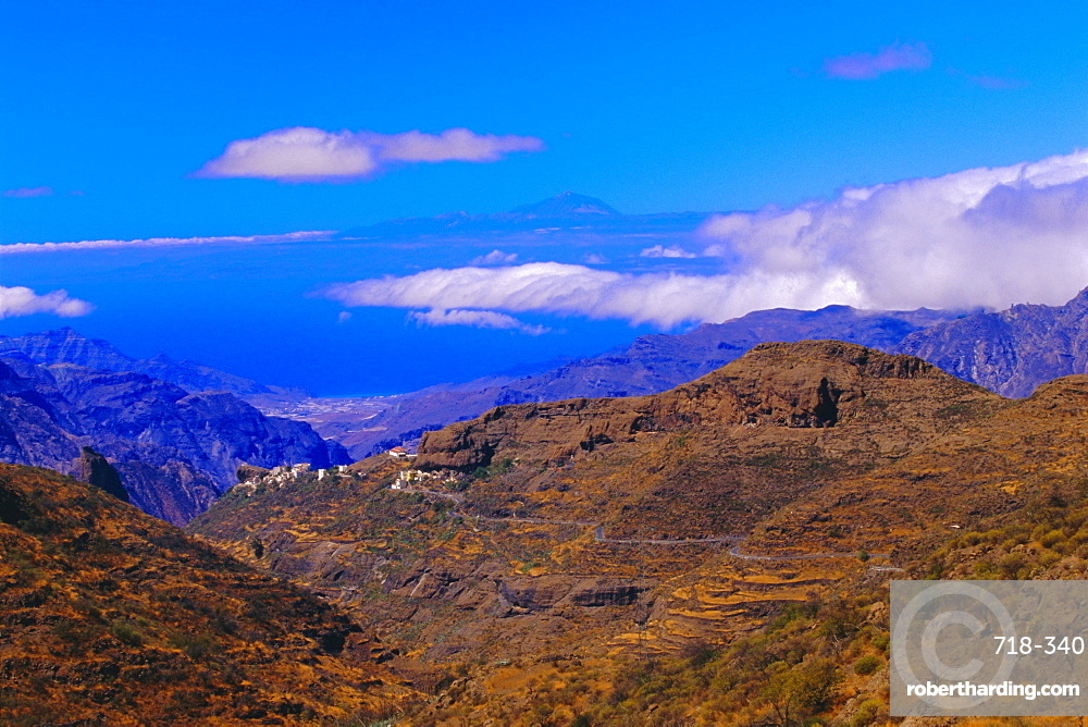 View of coast with Mount Teide in Tenerife in the background, Gran Canaria, Canary Islands, Spain