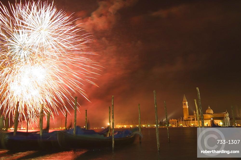 Carnival fireworks, gondolas on waterfront at night, San Giorgio Maggiore, Venice, UNESCO World Heritage Site, Veneto, Italy, Europe