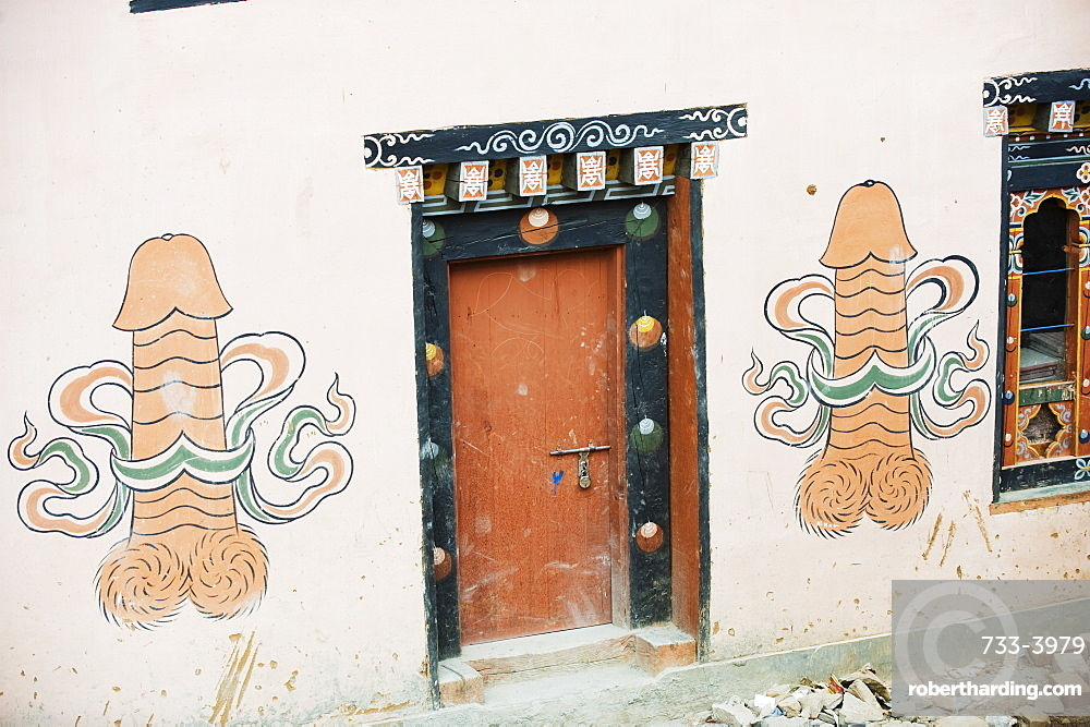 Phallic painting on a wall, at a town near the temple of the Divine Madman, Metshina, Punakha, Bhutan, Asia