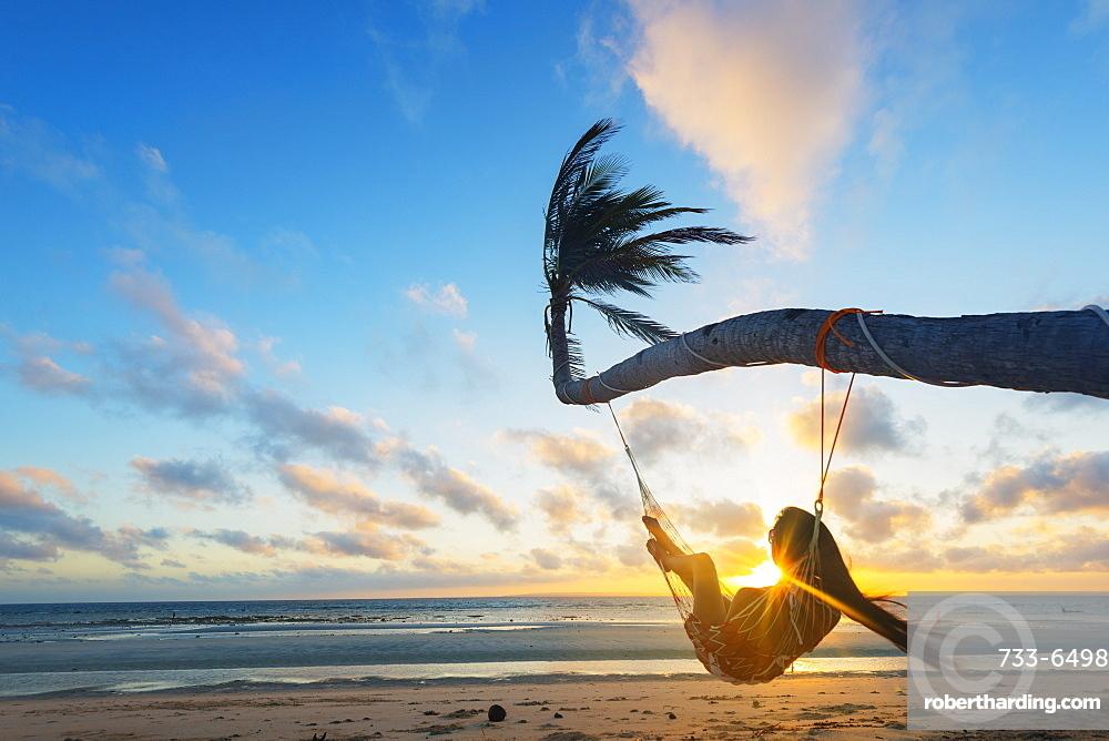 Girl in hammock on Sugar Beach, Bantayan Island, Cebu, The Visayas, Philippines, Southeast Asia, Asia