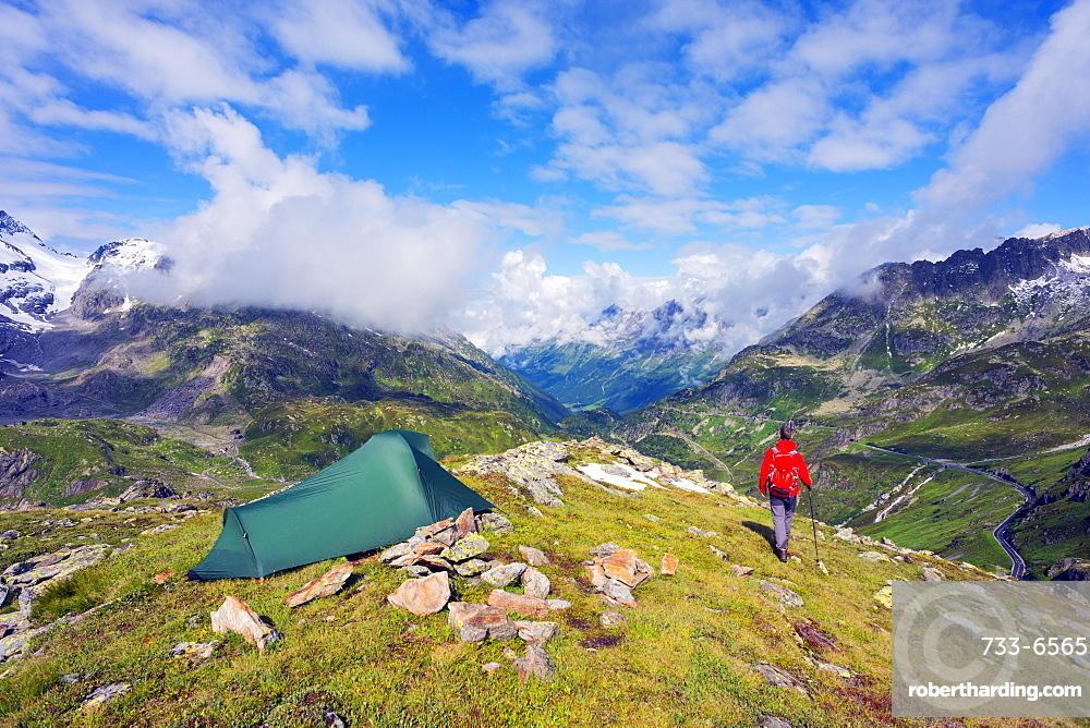 Hiker and camp site, Sustenpass (Susten Pass), Swiss Alps, Switzerland, Europe