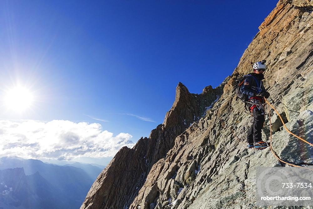 Climber on south ridge of Dent Blanche, 4357m, Valais, Swiss Alps, Switzerland, Europe