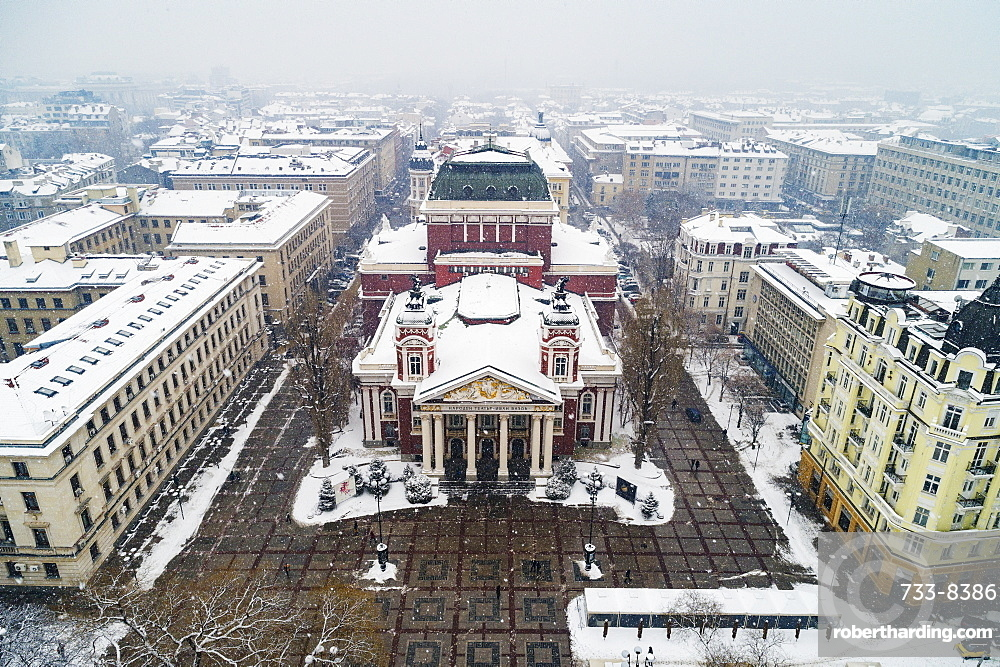 Aerial view of Ivan Vazov National Theatre in a snow storm, Sofia, Bulgaria, Europe