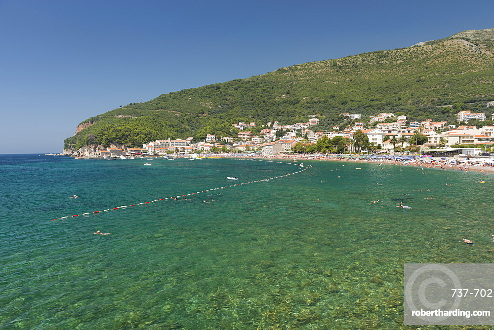 People swimming in Adriatic Sea, resort town of Petrovac, Montenegro, Europe