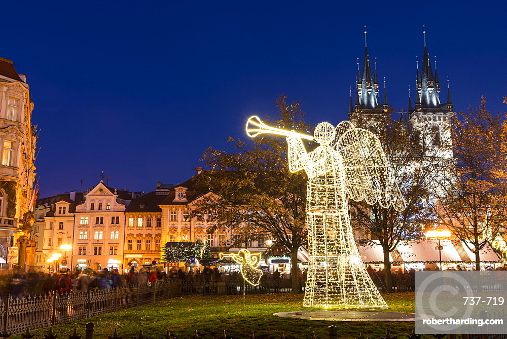 Christmas Market at Old Town Square, including angel, Rococo Kinsky Palace and Gothic Tyn Church, Old Town, UNESCO World Heritage Site, Prague, Czech Republic, Europe