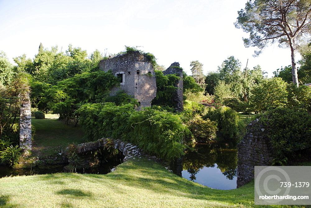 Ruins over the River Ninfa, the Gardens of Ninfa, Cisterna di Latina, Lazio, Italy, Europe