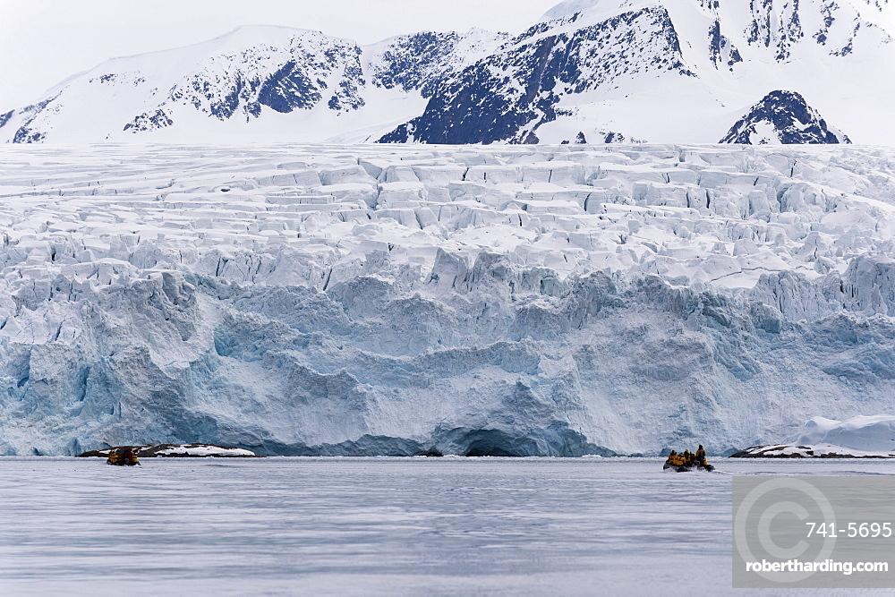 Tourist on inflatable boat exploring Fuglefjorden, Spitsbergen, Svalbard, Arctic, Norway, Europe, Norway.