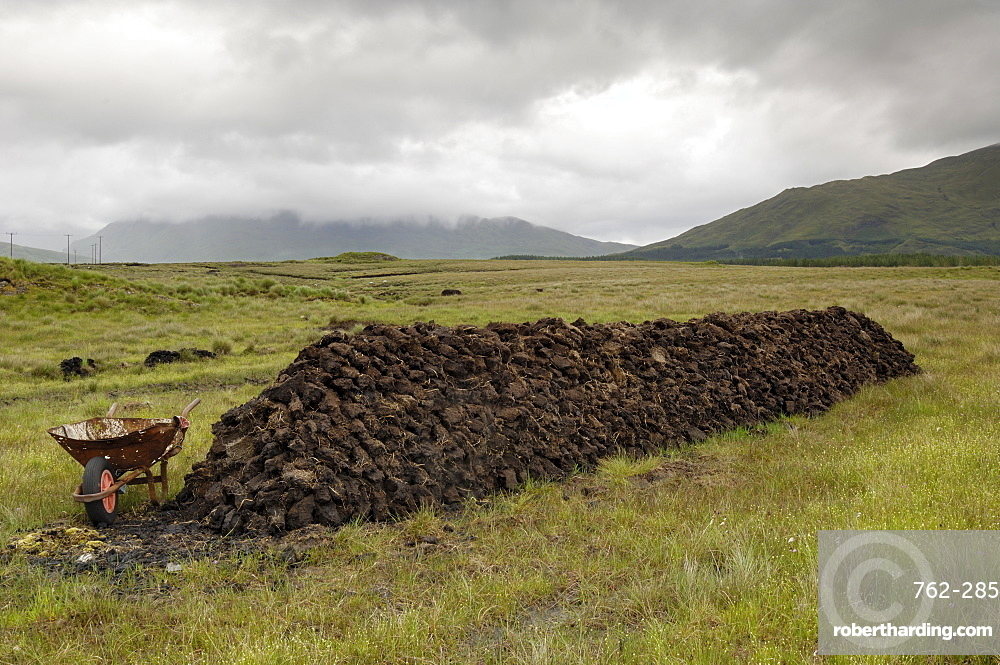 Cut peat stacked up for winter, Connemara, County Galway, Connacht, Republic of Ireland, Europe