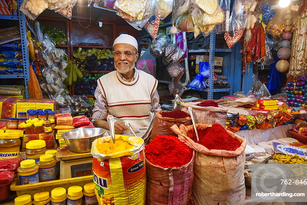 Vendor at stall in Krishnarajendra Market in Bangalore, Karnataka, India, Asia
