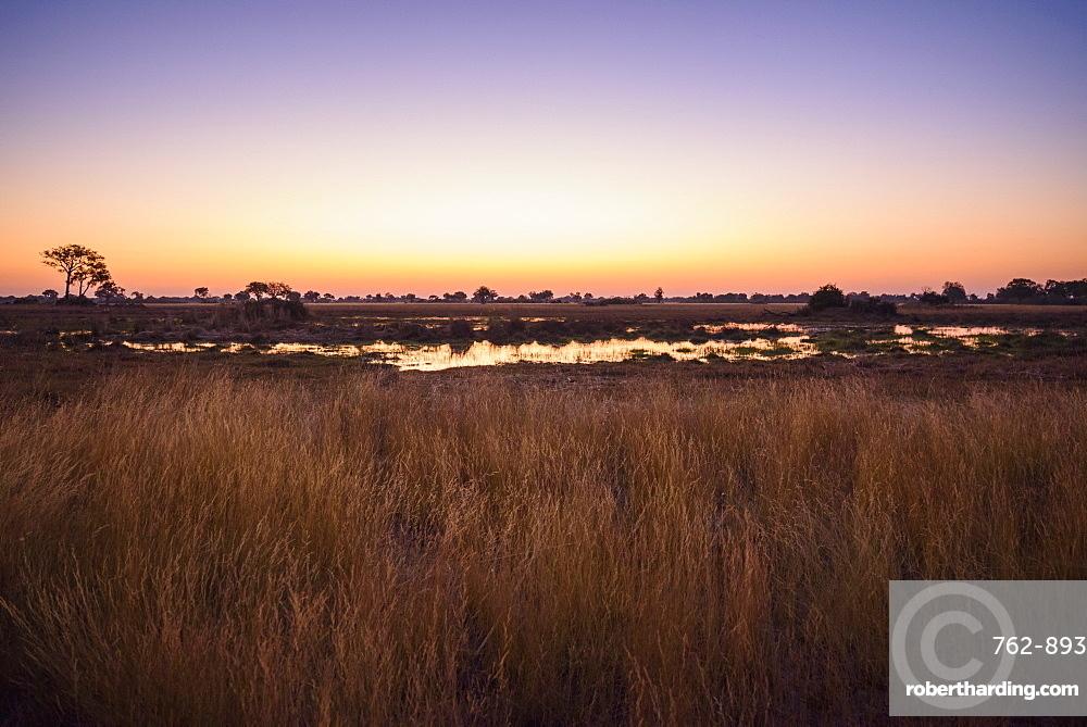 Sunset over the Bushman Plains, Okavango Delta, Botswana, Africa