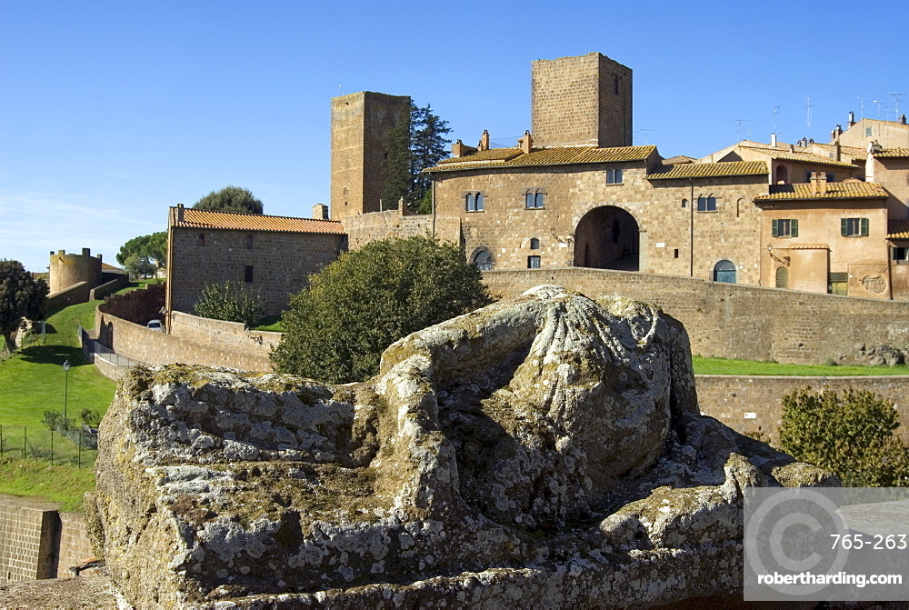 View of Tuscania from Bastianini Square and Etruscan sarcophagus, Latium, Italy, Europe