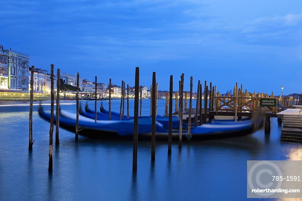 Gondolas moored at night at Campo della Salute on the Grand Canal, Venice, UNESCO World Heritage Site, Veneto, Italy, Europe
