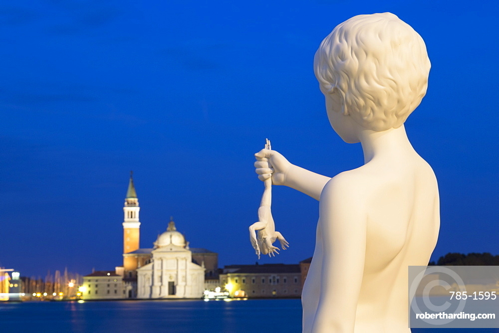 Night shot of Boy with Frog statue by Charles Ray, outside Dogana di Mare, with San Giorgio Maggiore in the distance, Venice, UNESCO World Heritage Site, Veneto, Italy, Europe