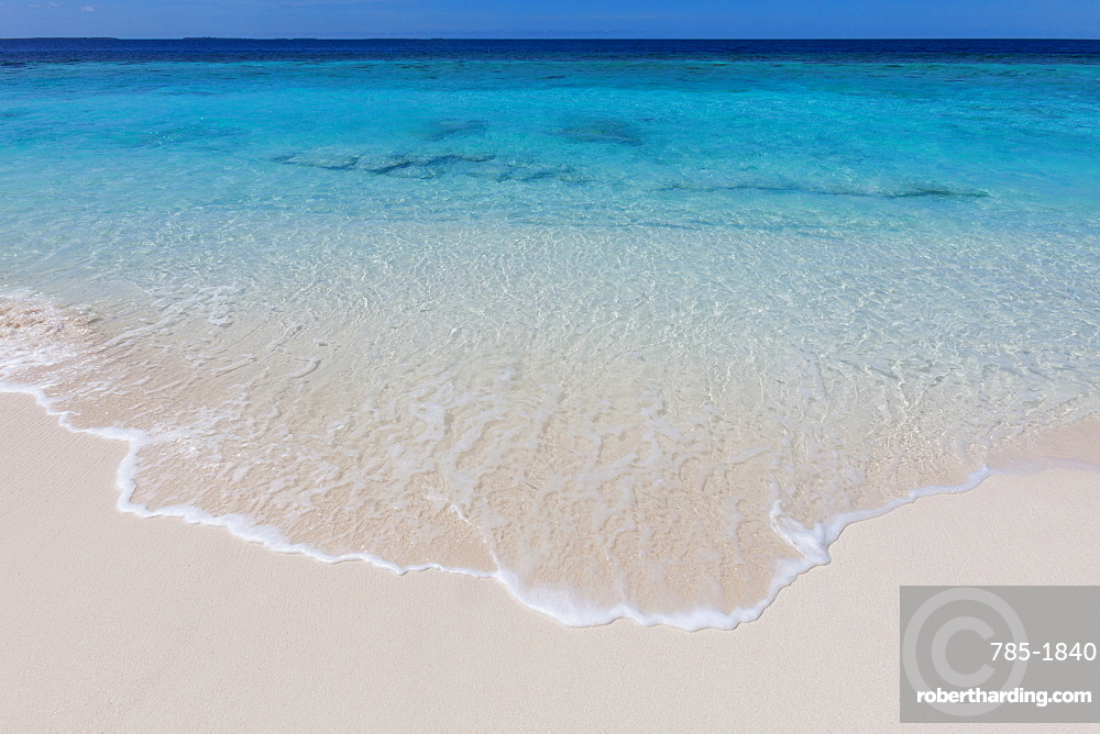 The crystal clear water of the Indian Ocean on an island in the Maldives, Indian Ocean, Asia