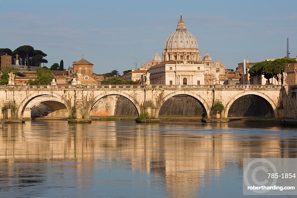 The River Tiber with Ponte Sant' Angelo bridge and St. Peter's Basilica, Rome, Lazio, Italy, Europe