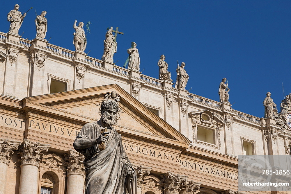 Statue and the facade of the Basilica of St. Peter's, UNESCO World Heritage Site, Vatican, Rome, Lazio, Italy, Europe