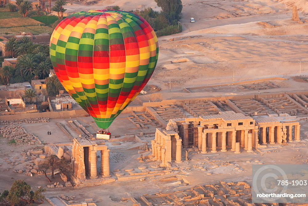 A hot air balloon flight over a ruined temple near Luxor, Thebes, Egypt, North Africa, Africa