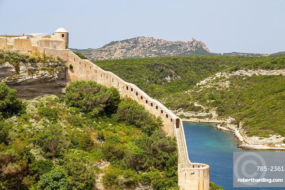 A section of the wall of the Citadel of Bonifacio perched on rugged cliffs, Bonifacio, Corsica, France, Mediterranean, Europe
