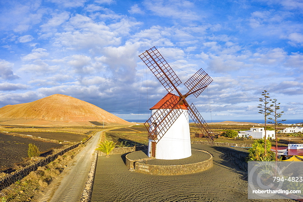 Spain, Canary Islands, Lanzarote, Tiagua, traditional windmill and volcanic landscape