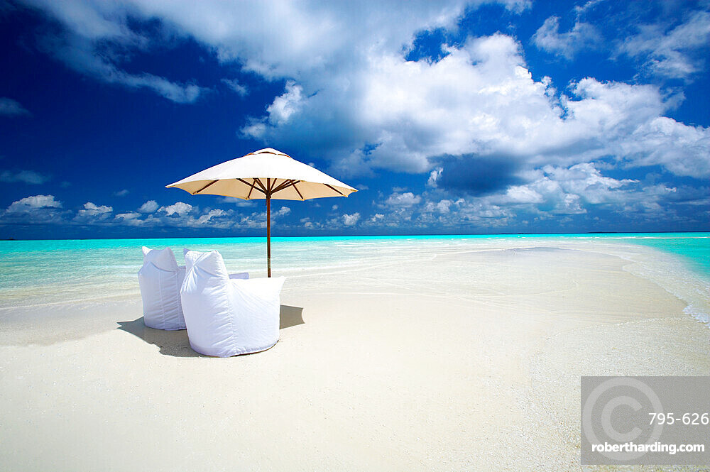 Two Lounge Chairs and Parasol on empty Beach, The Maldives, Indian Ocean, Asia