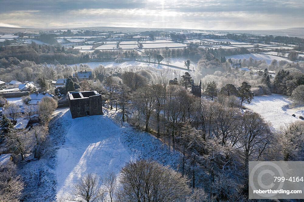 Aerial view of Lydford Castle on a snowy winter morning, Lydford, Devon, England, United Kingdom, Europe