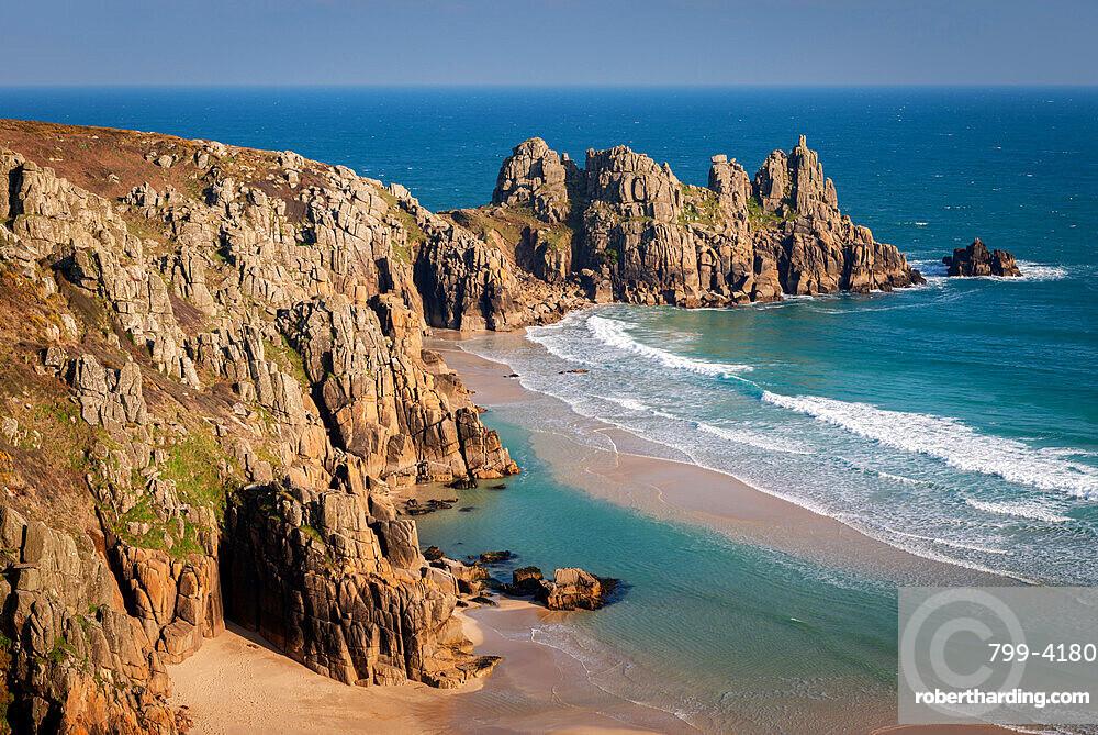 Treryn Dinas and Logan Rock across the beautiful sandy beach at Pedn Vounder, Cornwall, England, United Kingdom, Europe