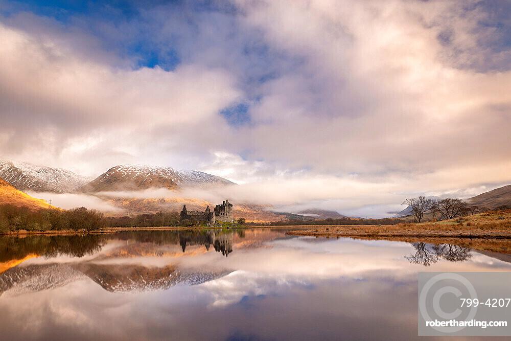 Kilchurn Castle reflected in Loch Awe at dawn in winter, Highlands, Scotland, United Kingdom, Europe