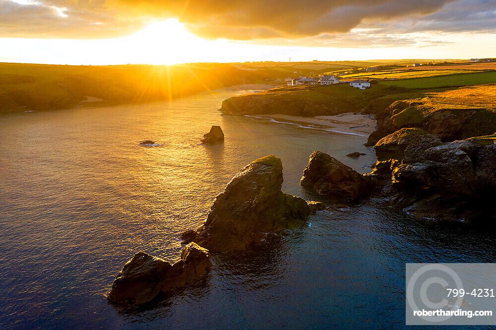 Summer sunrise over Porthcothan Bay on the North Cornwall coast, Cornwall, England, United Kingdom, Europe
