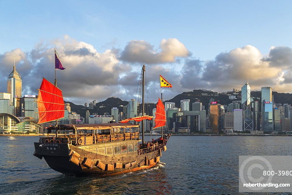 Junk boat and skyline of Hong Kong Island, Hong Kong, China, Asia