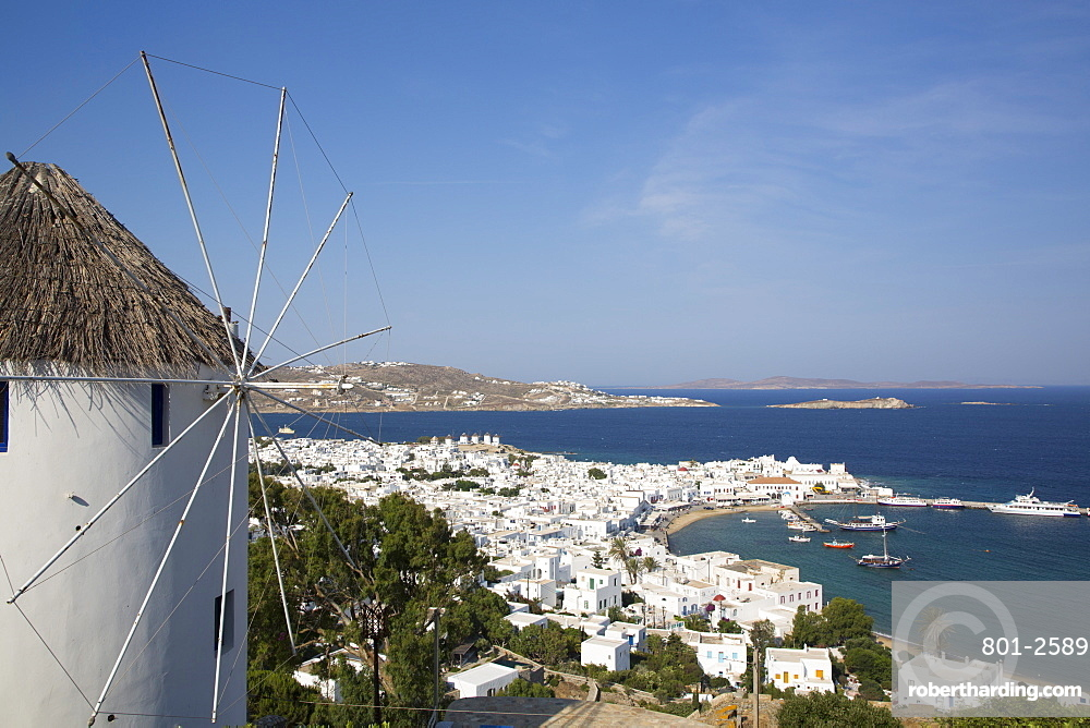 Windmill in foreground, Mykonos Town and Harbor, Mykonos Island, Cyclades Group, Greek Islands, Greece, Europe
