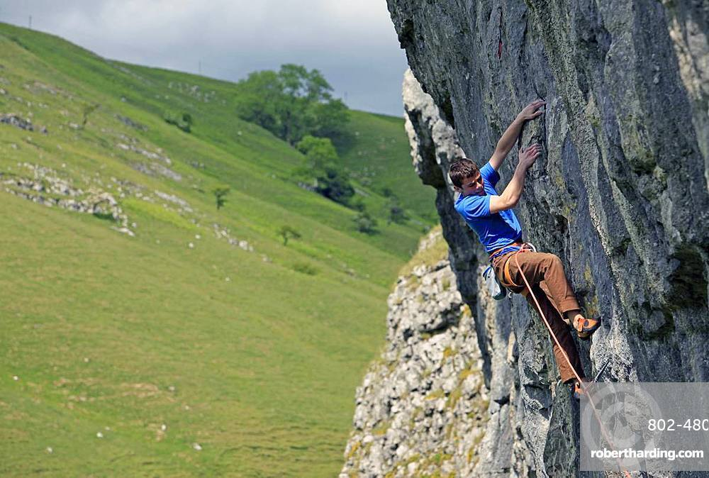 Rock climber in action, Yorkshire Dales National Park, North Yorkshire, England, United Kingdom, Europe