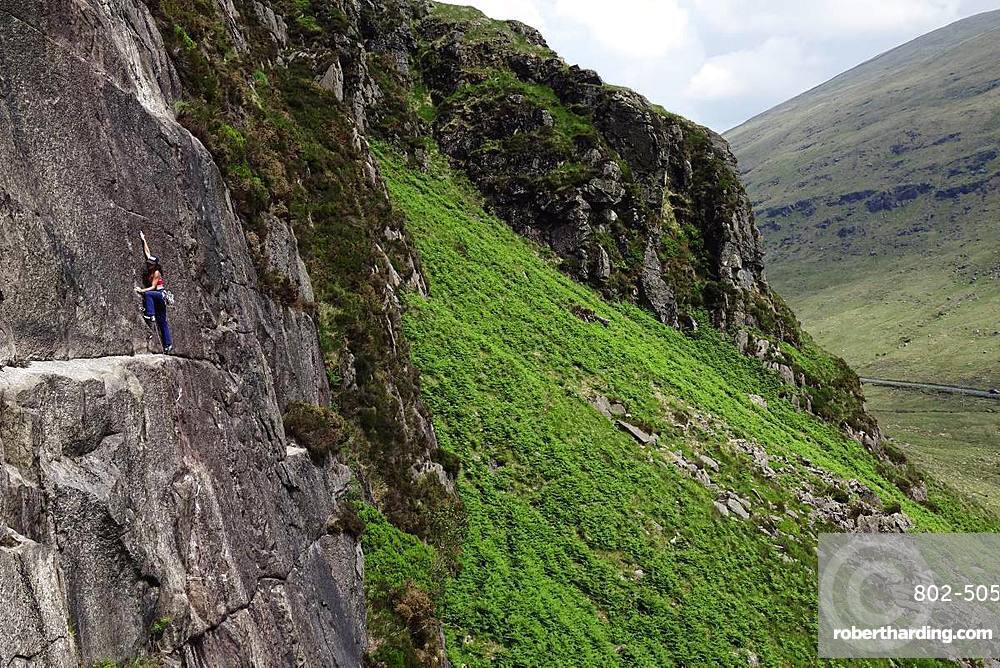 Rock climber in action in the Mourne Mountains, County Down, Ulster, Northern Ireland, United Kingdom, Europe