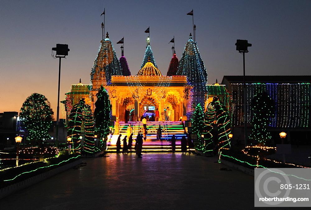 Diwali festival lights illuminating the entrance to the white marble Swaminarayan Temple, Mandvi, Gujarat, India, Asia