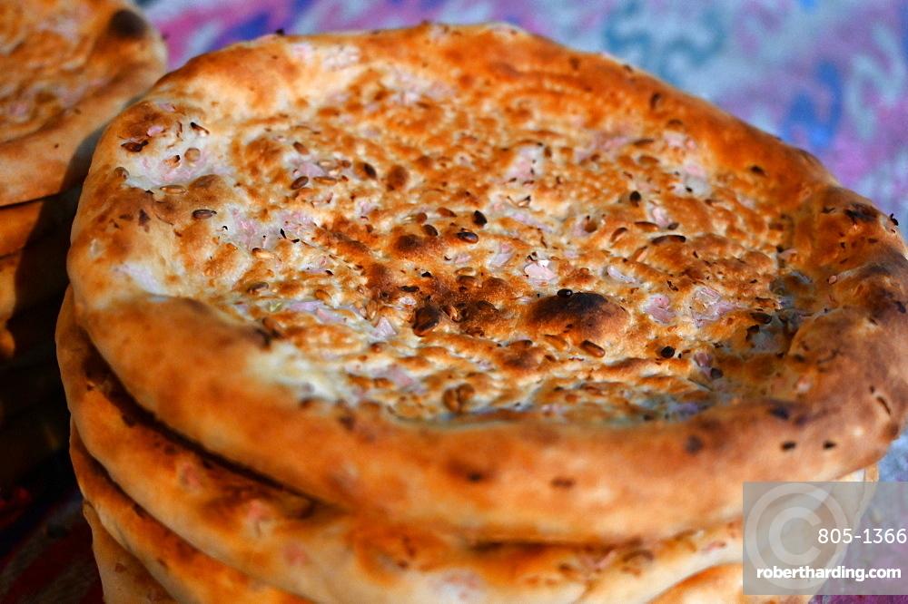Freshly baked flatbreads for sale in Turfan street night market, Turfan, Xinjiang, China, Asia