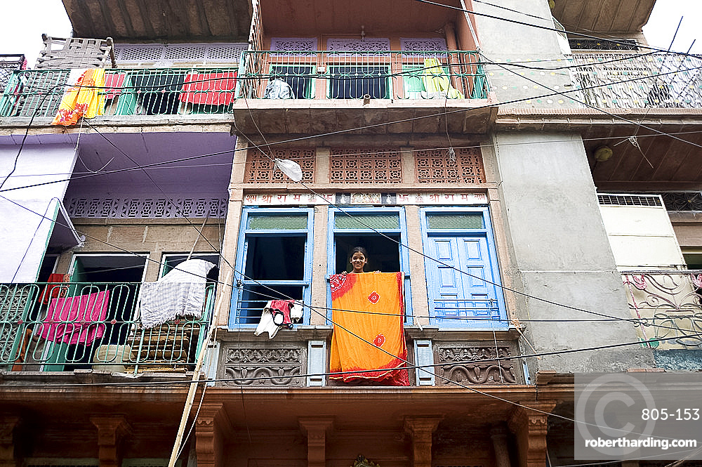 Girl at window with sari drying, Jodhpur, Rajasthan, India, Asia