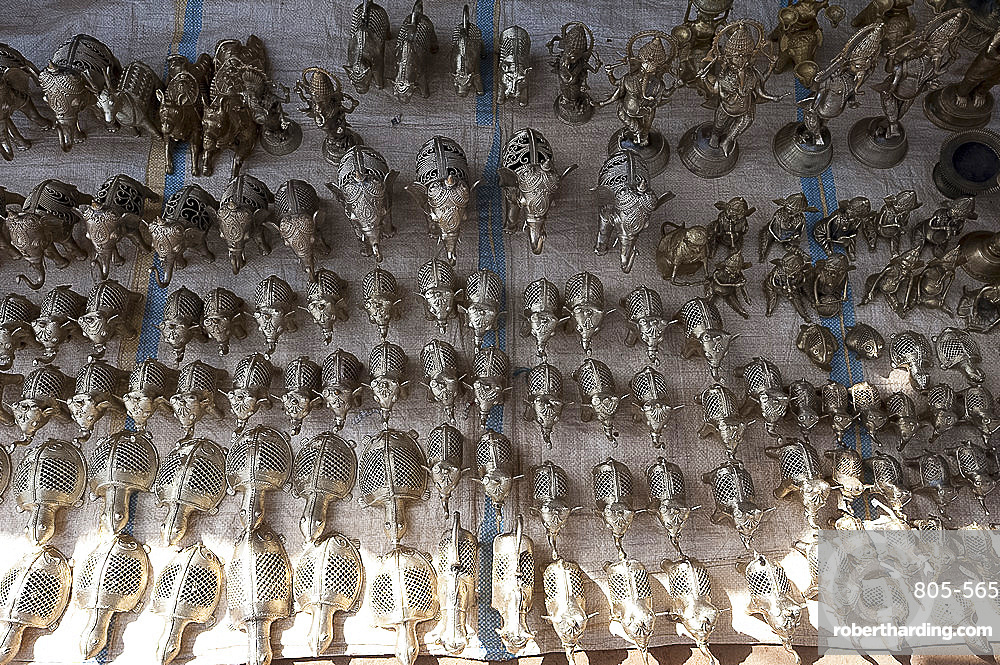Small brass animals made by the lost wax method in untouchable brassmaking village, rural Orissa, India, Asia