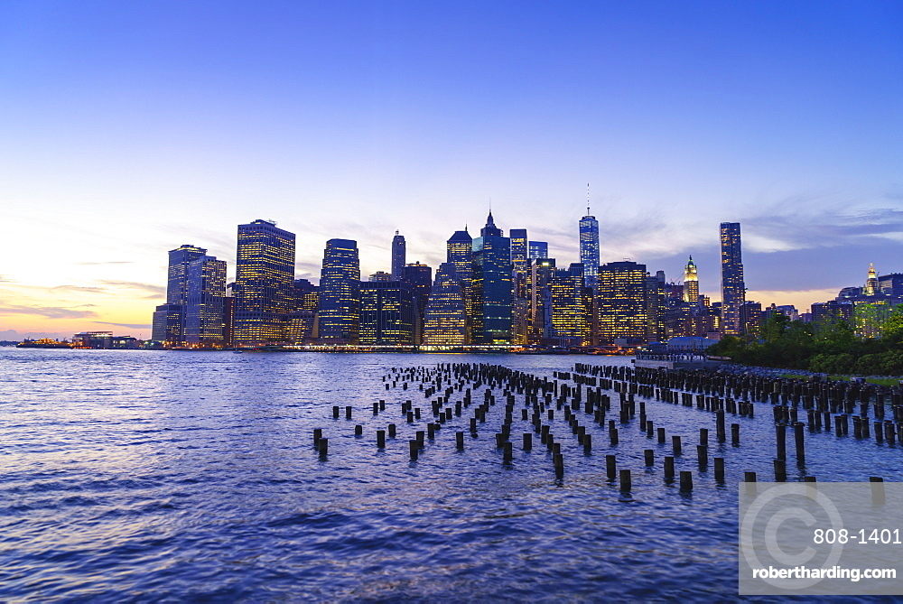 Lower Manhattan skyscrapers including One World Trade Center at sunset from across the East River, Financial District, Manhattan, New York City, United States of America, North America