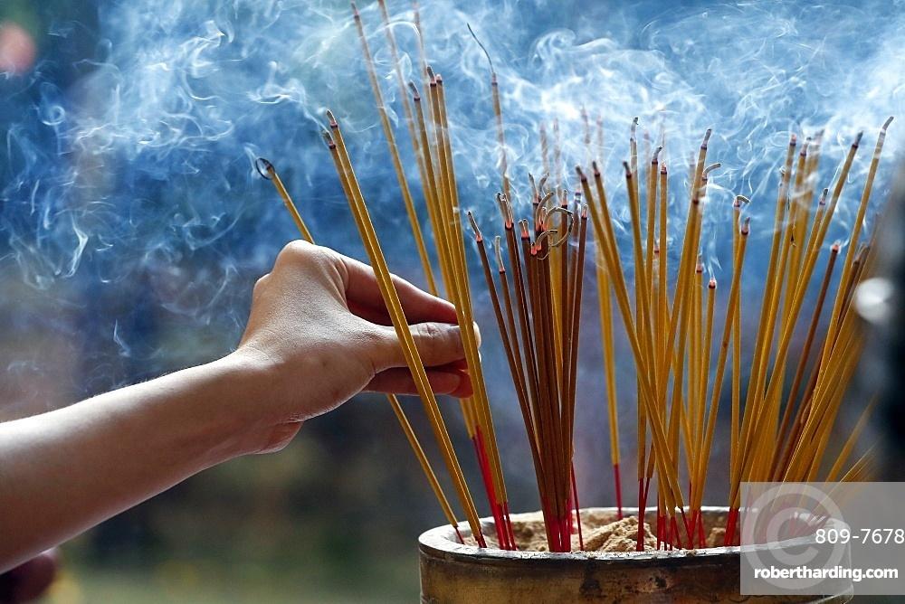 Emperor Jade pagoda (Chua Phuoc Hai), incense sticks on joss stick pot burning, smoke used to pay respect to the Buddha, Ho Chi Minh City, Vietnam, Indochina, Southeast Asia, Asia