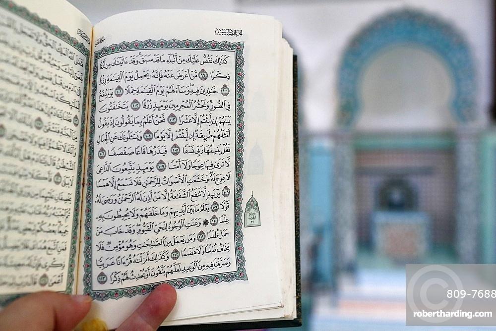 Mubarak Mosque, Muslim man reading an Arabic Holy Quran (Koran), Chau Doc, Vietnam, Indochina, Southeast Asia, Asia